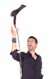 Male barber catching hair dryer Royalty Free Stock Image