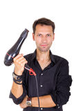 Male barber with hair dryer. Young male barber with hair dryer posing stock photography