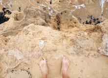 Male bare feet stand on coastal sandstone. Rock. Travel lifestyle background Stock Photos