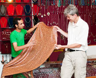 Male bargaining in the Indian store. Male torist bargaining in the Indian store, buy silk Stock Image