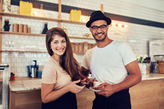 Male barista standing at coffee shop Royalty Free Stock Images