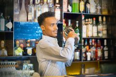 Male bartender makes a cocktail royalty free stock image