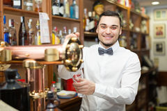 Male bartender in modern bar Royalty Free Stock Photo