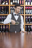 Male Bartender Pouring White Wine In Glass Stock Photography