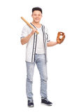 Male baseball player holding bat and a ball Royalty Free Stock Photography