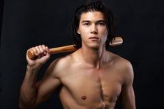 Male baseballer. Image of shirtless man with bat looking at camera Royalty Free Stock Photography