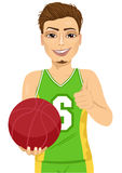 Male basketball player holding ball Royalty Free Stock Images