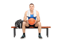Male basketball player sitting on a bench Royalty Free Stock Photography