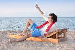 Male at beach. Cute male at beach making sign to his friends Royalty Free Stock Photo