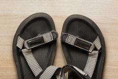 Male beach sandals on wooden background. Closeup Royalty Free Stock Photo