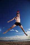 Male beach volleyball game player jump in blue sky Stock Image