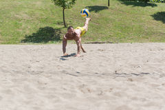 Male Beach Volleyball Game Player Jump On Sand Stock Photo