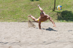 Male Beach Volleyball Game Player Jump On Sand Royalty Free Stock Photos