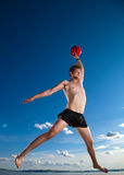 Male beach volleyball game player jump in sky Stock Photo