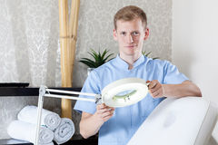 Male beautician waiting for customer Royalty Free Stock Photo
