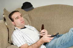 Male With Beer Watching TV Stock Images