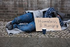 Male Beggar Lying On Street stock photography