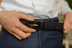 Male belt brown color. White shirt, groom Royalty Free Stock Photography