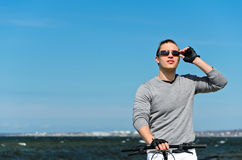 Male with bicycle by the sea Stock Images