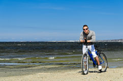Male with bicycle by the sea Royalty Free Stock Photography