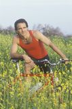Male bicyclist in field of Spring flowers, Malibu, CA Royalty Free Stock Image