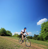 Male bicyclist riding a mountain bike downhill Stock Image