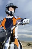 Male Bike Rider With His Motor Bike royalty free stock images