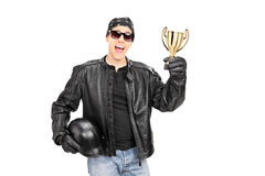 Male biker with headscarf holding a trophy Royalty Free Stock Photography