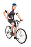 Male biker with helmet posing on a bike Royalty Free Stock Image