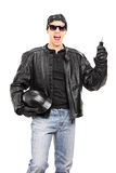 Male biker holding key and a helmet Royalty Free Stock Images