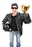 Male biker holding a trophy isolated on white background Royalty Free Stock Photo