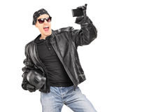 Male biker in leather jacket taking picture of himself Stock Photo