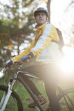 Male biker with mountain bike in forest Stock Image