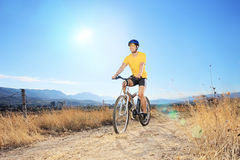 Male biker riding outdoors on a sunny day Stock Photography