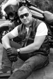 Male biker sits off a motorcycle royalty free stock photo