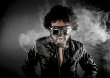 Male biker with sunglasses era dressed Leather jacket, huge smok Royalty Free Stock Images