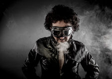 Male biker with sunglasses era dressed Leather jacket, huge smok Stock Photo