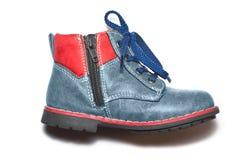 Male blåttläder skor Arkivbild