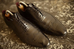 Male black leather shoes. Black leather man shoes on the floor Royalty Free Stock Images