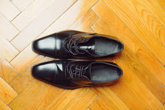 Male Black Shoes. Closeup of male shoes on carpet Royalty Free Stock Photos