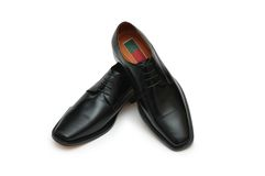 Male black shoes isolated on t. He white Royalty Free Stock Images