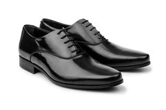 The male black shoes isolated on white royalty free stock images