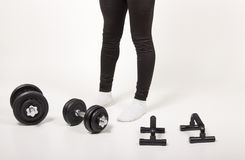 Male in black tights with weights, and pull up handles. On white background Stock Image