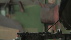 Male Blacksmith Straightening Iron Rod With The Help Of Guides stock video footage