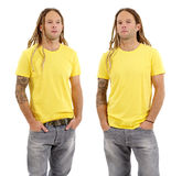 Male with blank yellow shirt and dreadlocks. Photo of a male in his early thirties with long dreadlocks and posing with a blank yellow shirt.  Two different Royalty Free Stock Images