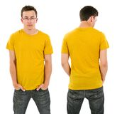 Male with blank yellow shirt and glasses. Photo of a male in his late teens posing with a blank yellow shirt.  Front and back views ready for your artwork or Stock Photo