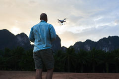 Male blog author is taking photos on flying multicopter during trip in Asia Royalty Free Stock Photo