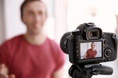 Male blogger on camera screen near window,. Closeup Stock Photography