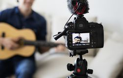 Male blogger recording music related broadcast at home Stock Photography