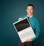 Male in blue with laptop. Male in blue with open laptop in his hands Royalty Free Stock Photo